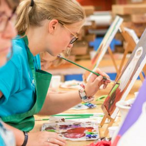 MAT Campers learning to paint with oil paints