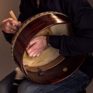 David Brewer from The Fire playing a bodhran - a Celtic drum - Ceili at the Roundhouse Celtic Festival
