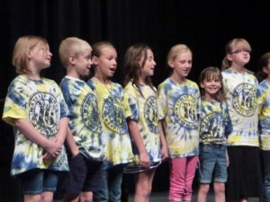 MAT Camp students performing during an evening concert