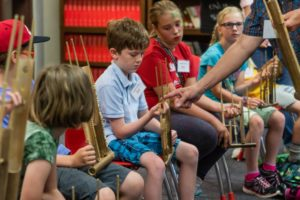 Learning a new instrument at MAT Camp