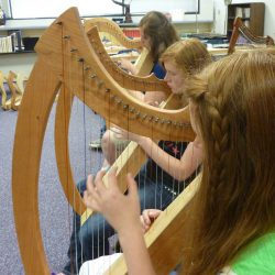 MAT Camp students learning to play the harp